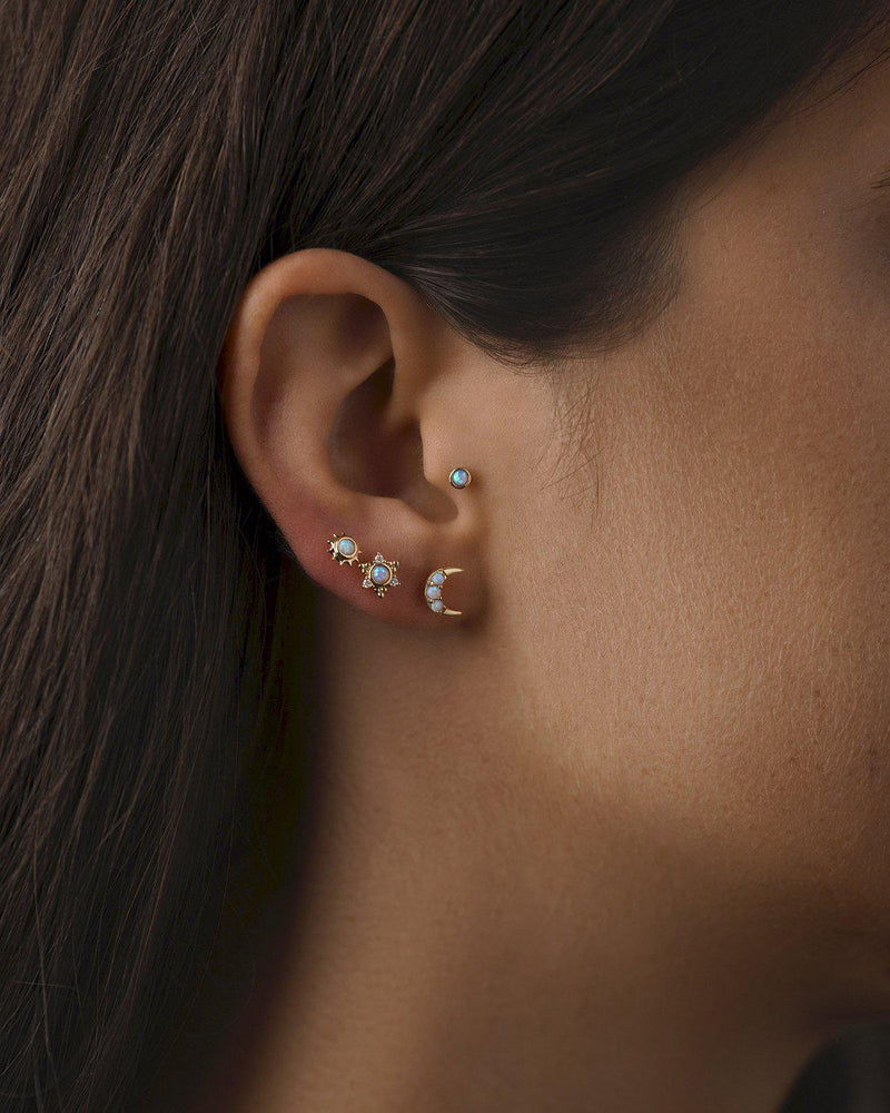 celestial opal stud piercings on the model
