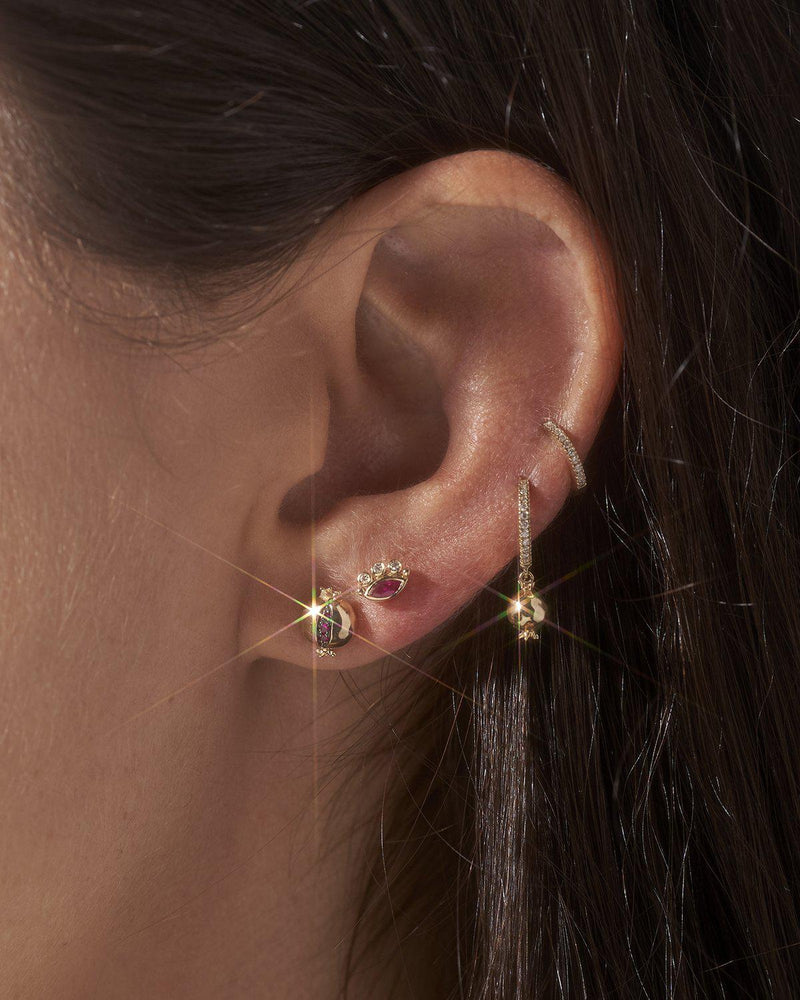 gold pomegranate stud earring on the model
