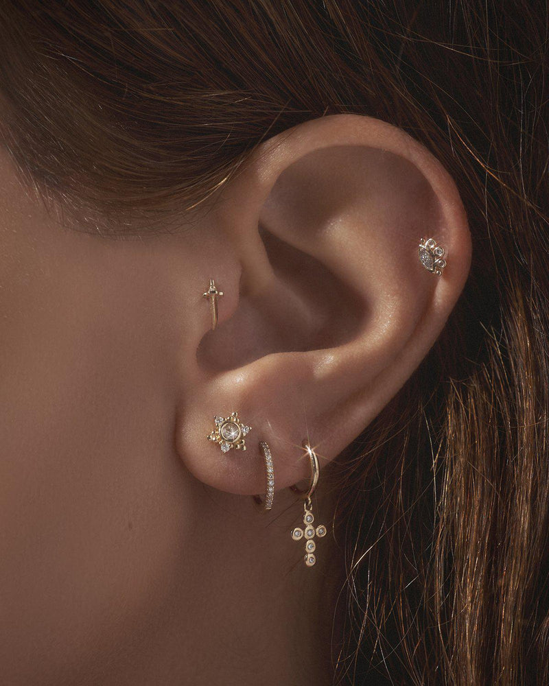 diamond ear piercings on the model