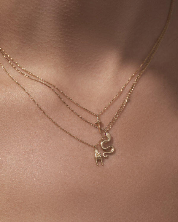 gold pendant necklaces on the model