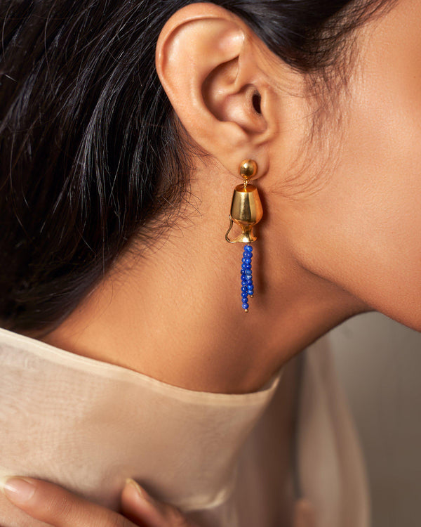 vessel earrings with lapis on the model