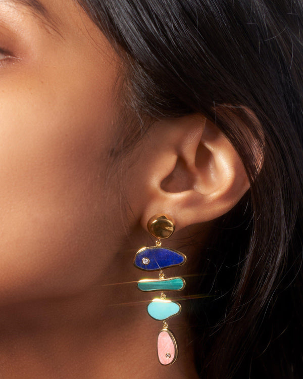 palma earrings on the model