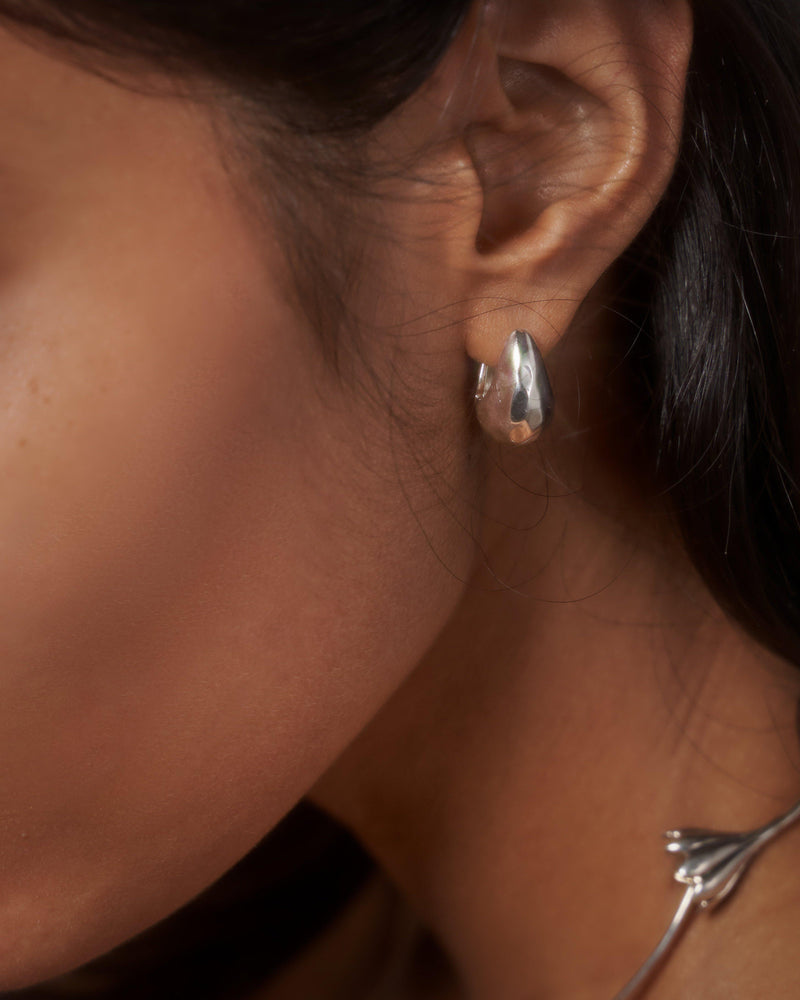 hammered hoop earrings on models ear
