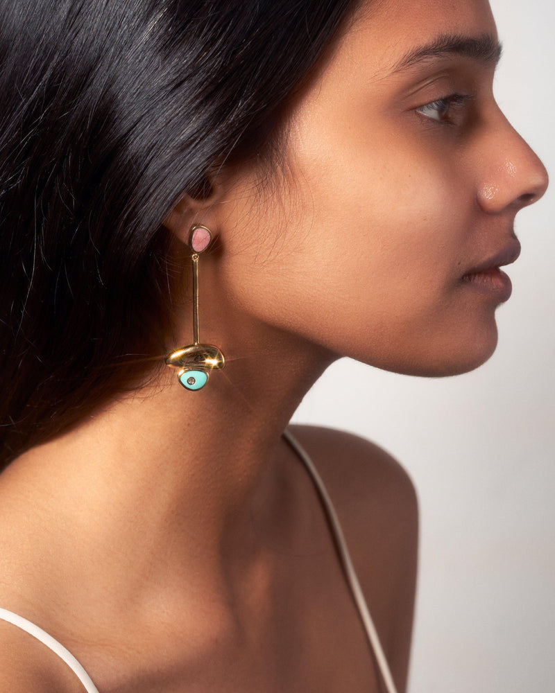 pendulum earrings on the models ear
