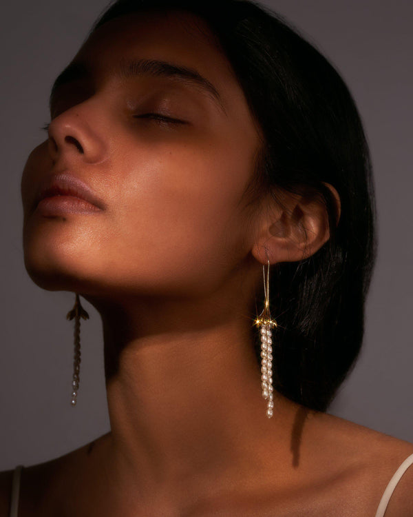 pearl drop earrings on the model