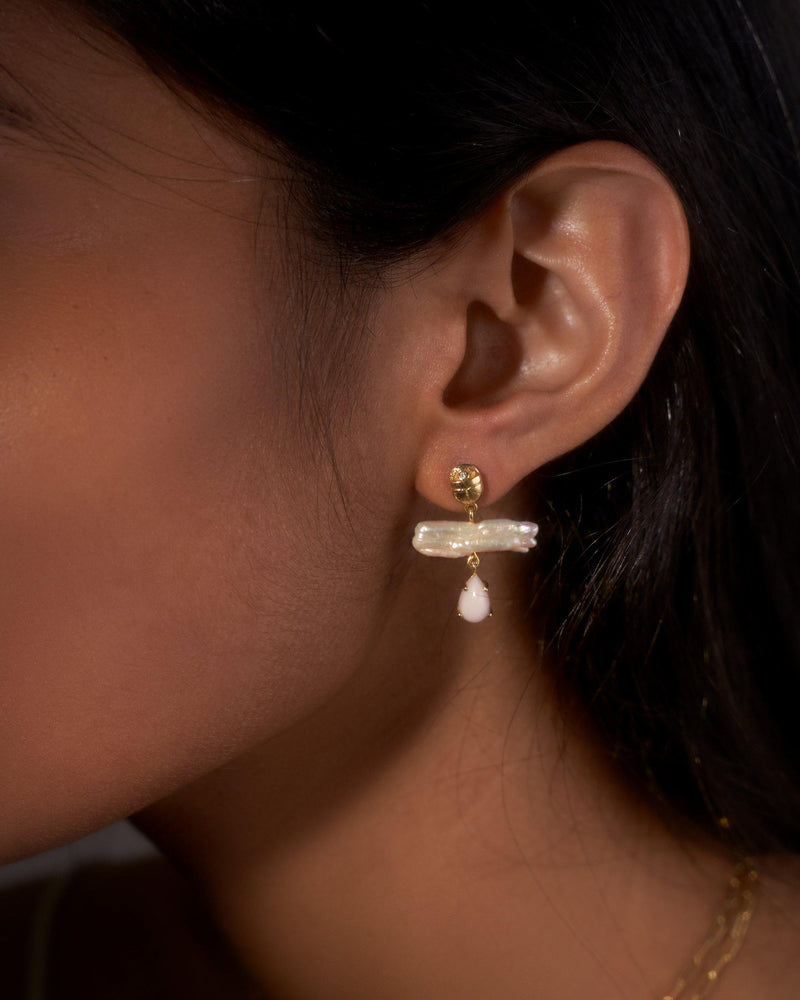 biwa earrings on the model