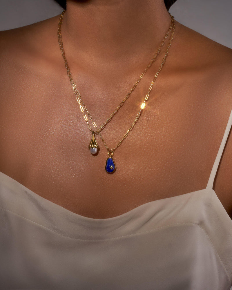 pilar 2 pendant necklaces on the model