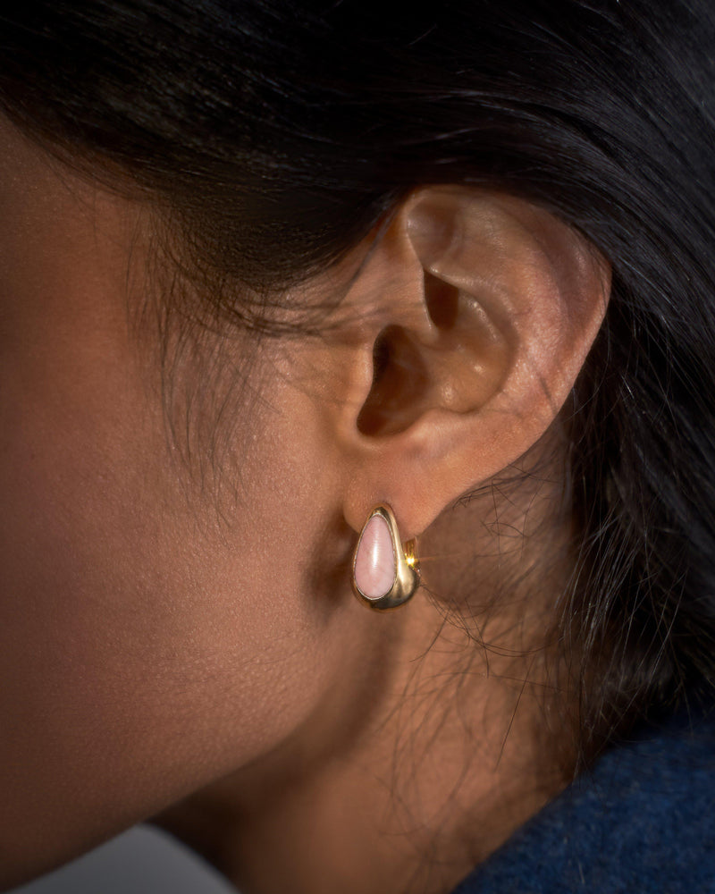 pink opal inlay hammered hoop earrings on the model