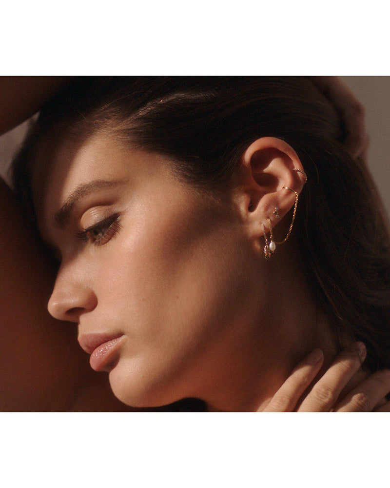 Sara Sampaio with earrings by Pamela Love
