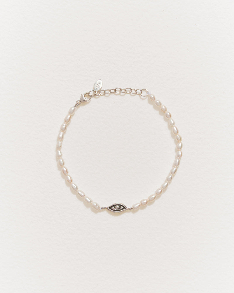 pearl bracelet with rice pearls and eye motif