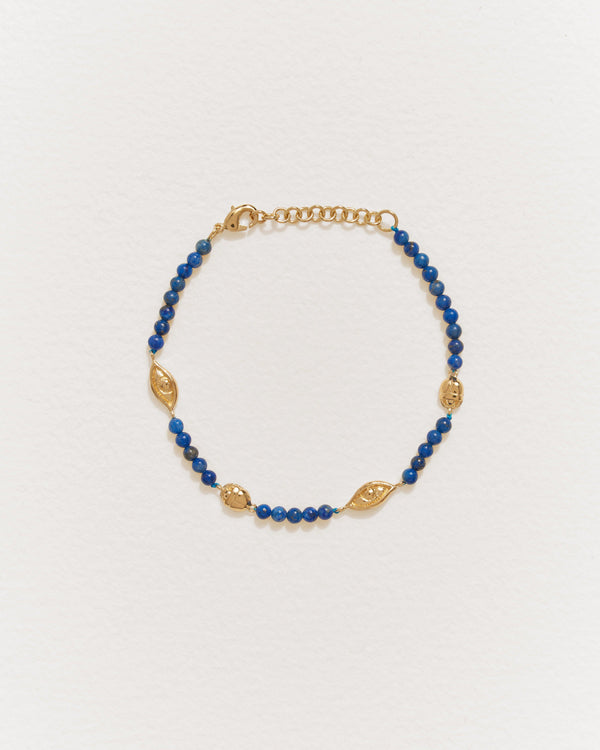 eye line bracelet with 14k gold plate and lapis lazuli
