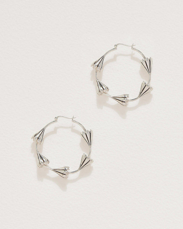 silver anemone flower hoop earrings