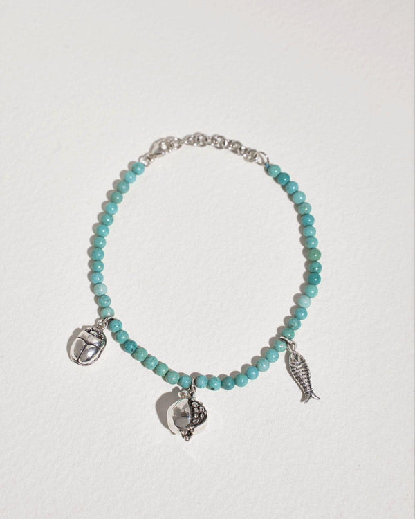 journey bracelet with turquoise and silver and multi charms