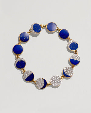 moon phase bracelet with yellow gold, white diamonds and lapis inlay