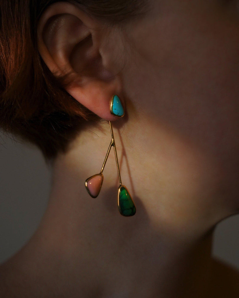 satellite earrings on the model