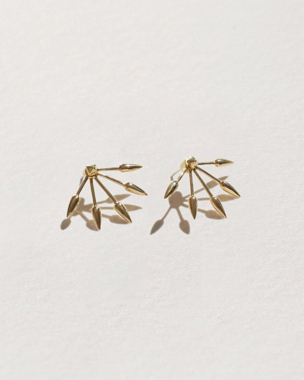 five spike earrings