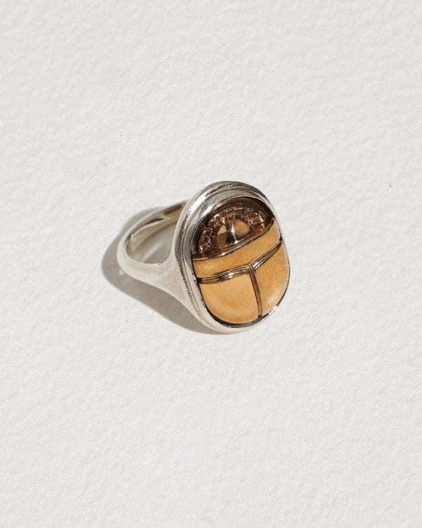 silver and brass scarab ring