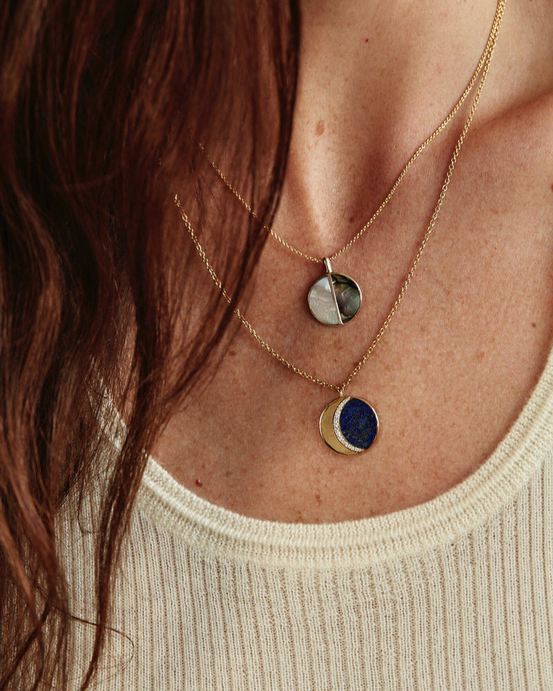 moon phase pendant necklace on the model