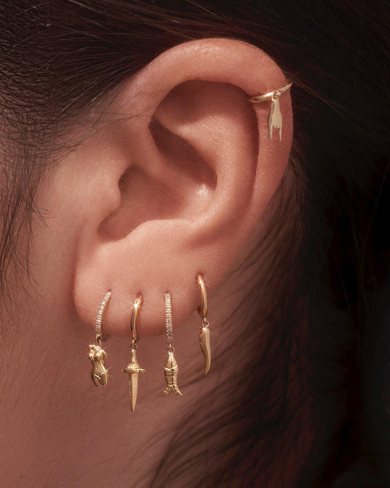dagger earring on the model
