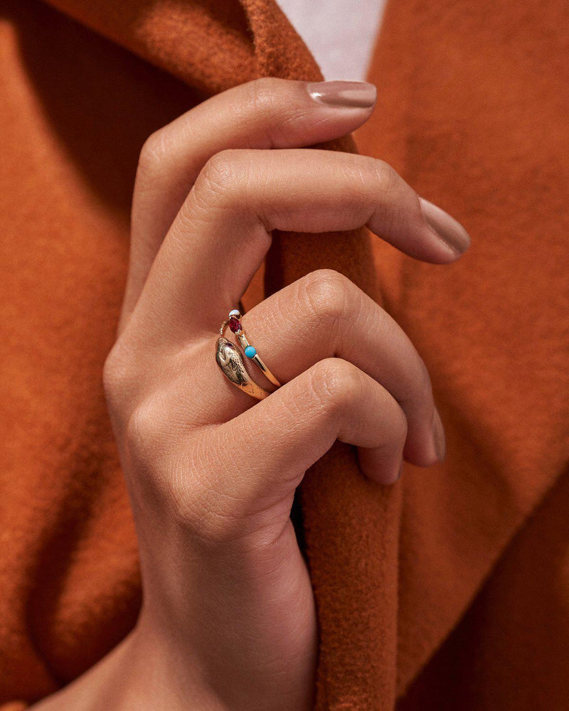 multi stone ring on models hand