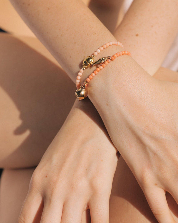 scarab bracelets on the model