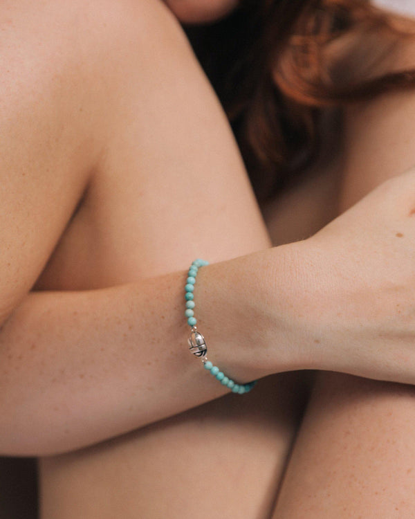 turquoise beaded scarab bracelet on the model