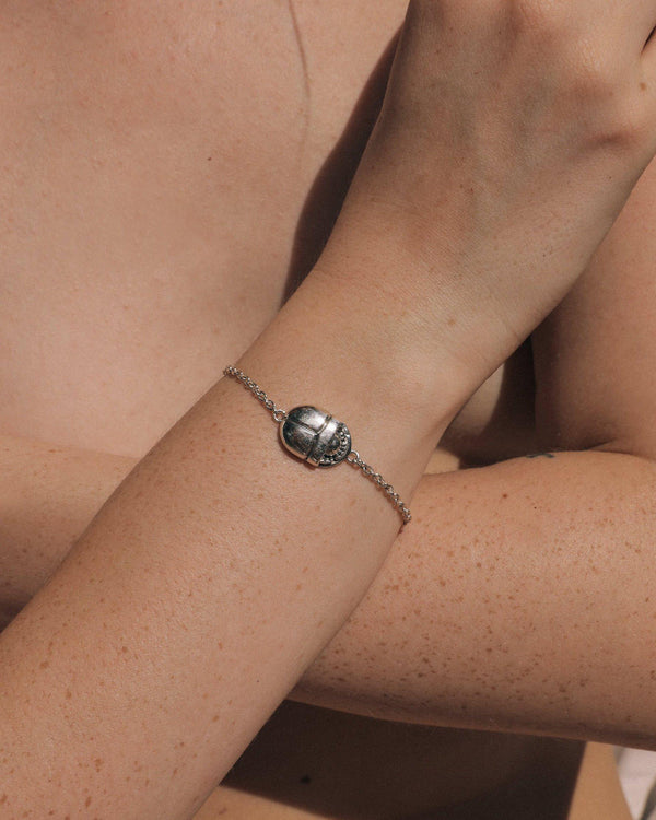 silver scarab chain bracelet on the model