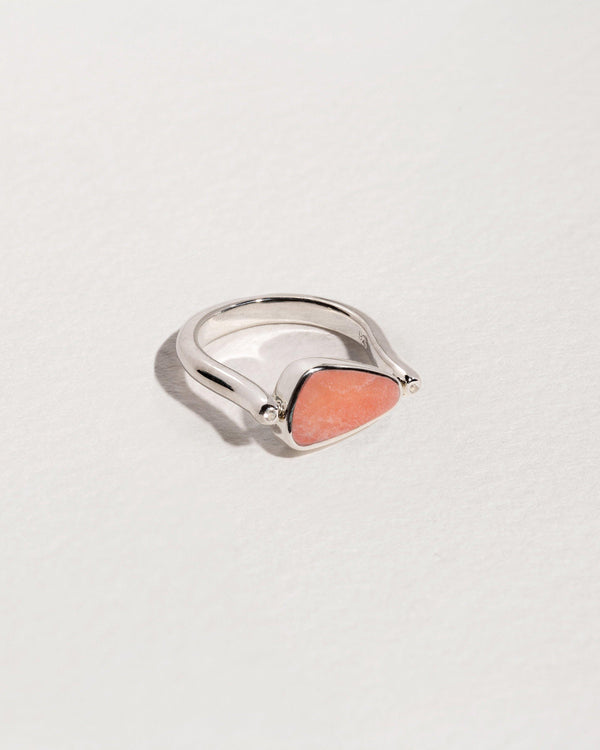 rotating pilar ring with sterling silver, white topaz and pink opal