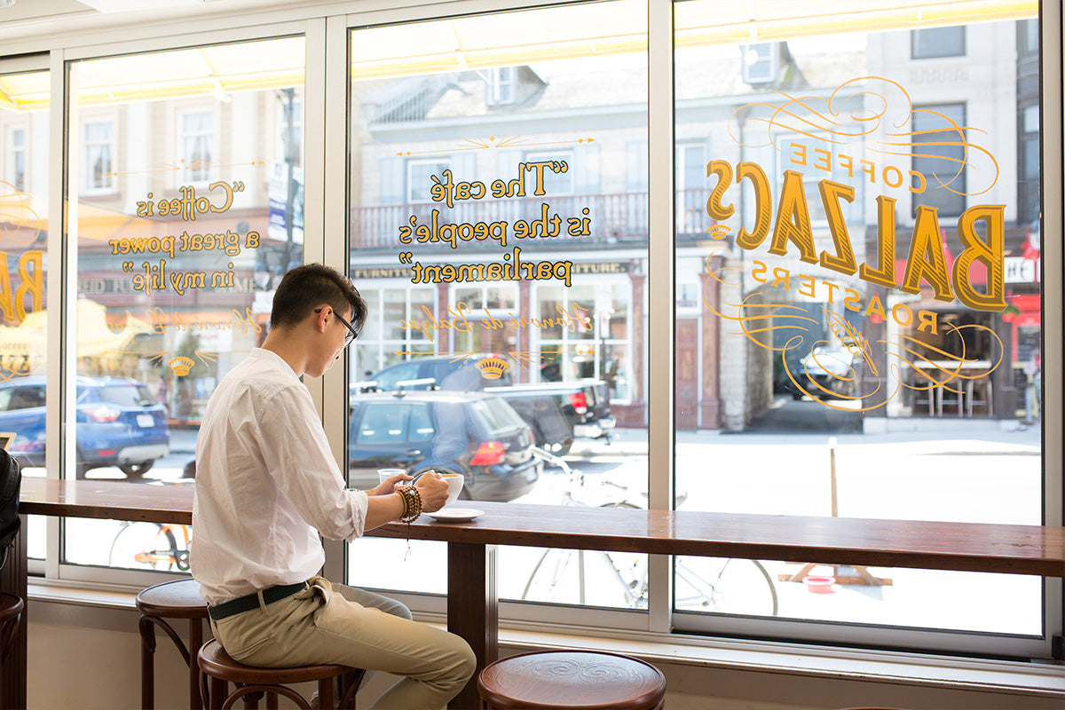 Balzacs Coffee Kingston Man sitting at window