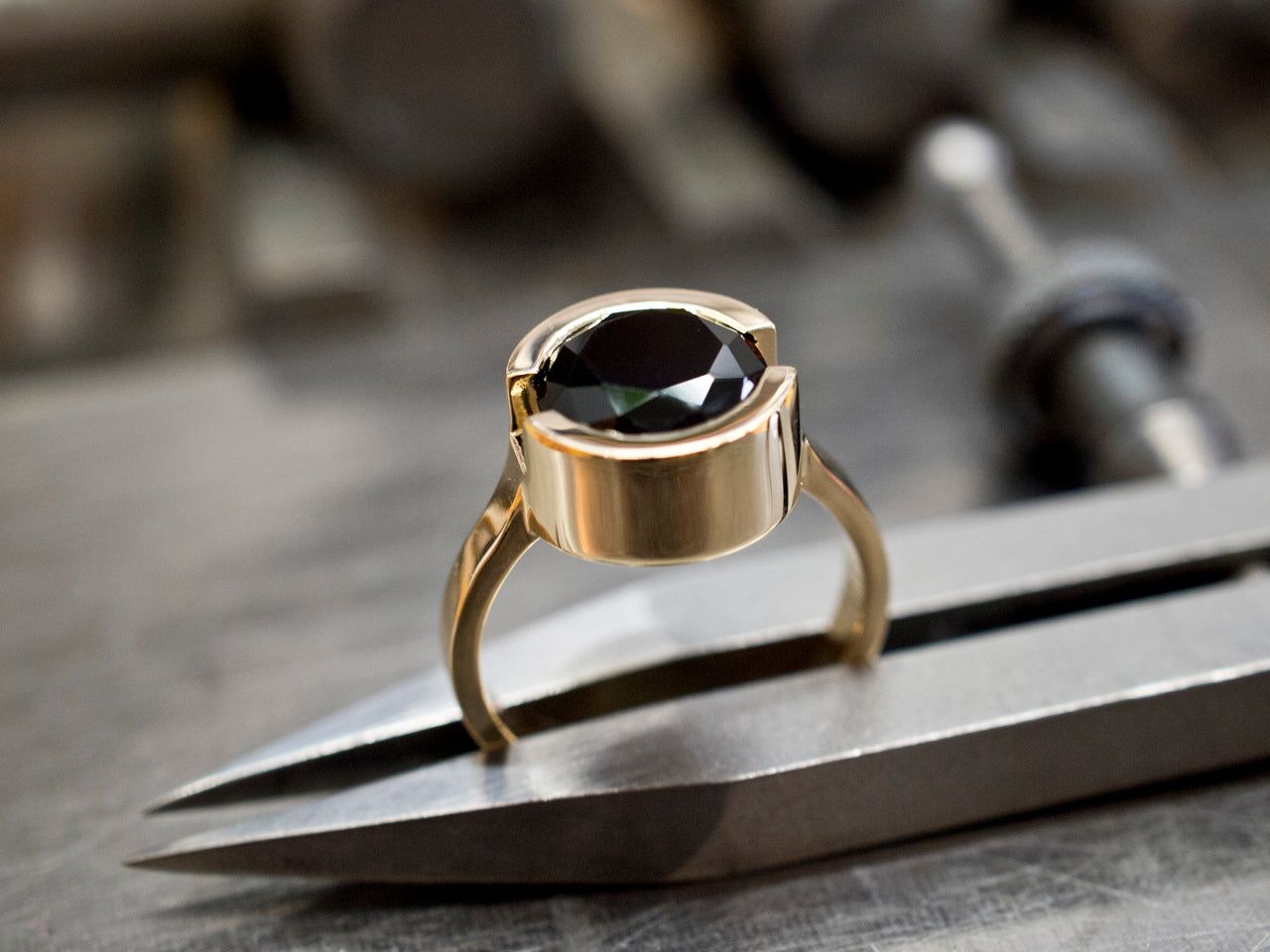 14k gold with onyx.