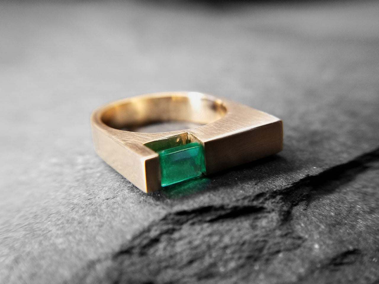 14k yellow gold with emerald