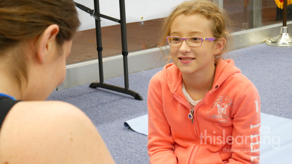 Jamie connects children to mindfulness with yoga