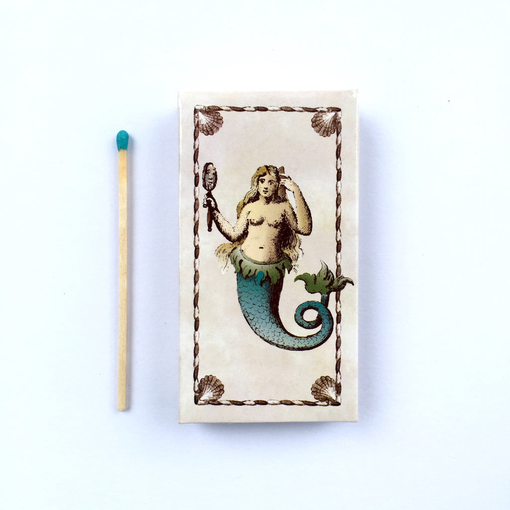 These Mermaid/Merman jumbo matches are perfect for lighting our hand poured soy candles!  These decorative matches are a lovely addition to enhance any home décor.  Our designer match boxes are reusable, and each comes with 50 matches tipped in blue.