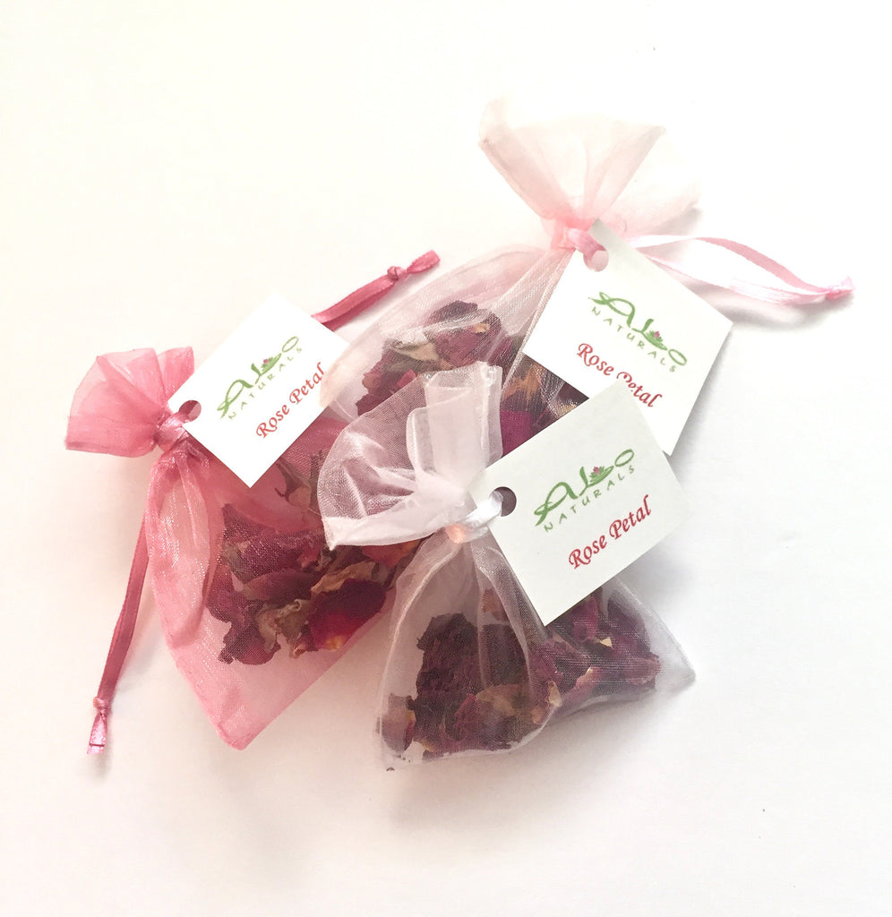 These beautiful sachets are handmade with red rose buds!  Roses are known to be a great antidepressant and aphrodisiac.  They have a naturally beautiful scent to brighten any drawer, bag, suitcase, purse, or car.