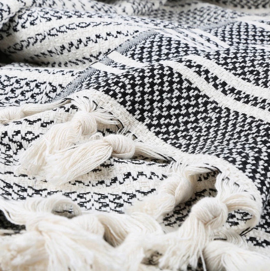 "Ready to get cozy? This throw blanket is hand loomed with 100% Turkish cotton, in a stylish striped pattern of black and natural colors. Turkish cotton is known for its softness, comfort, light weight, hypoallergenic, and antimicrobial properties. It can be used as a throw blanket on a bed, couch, picnic, or even at the beach! Get ready to stay warm and comfy! Fair trade. Measure 71""x 94.5"". XL King size."