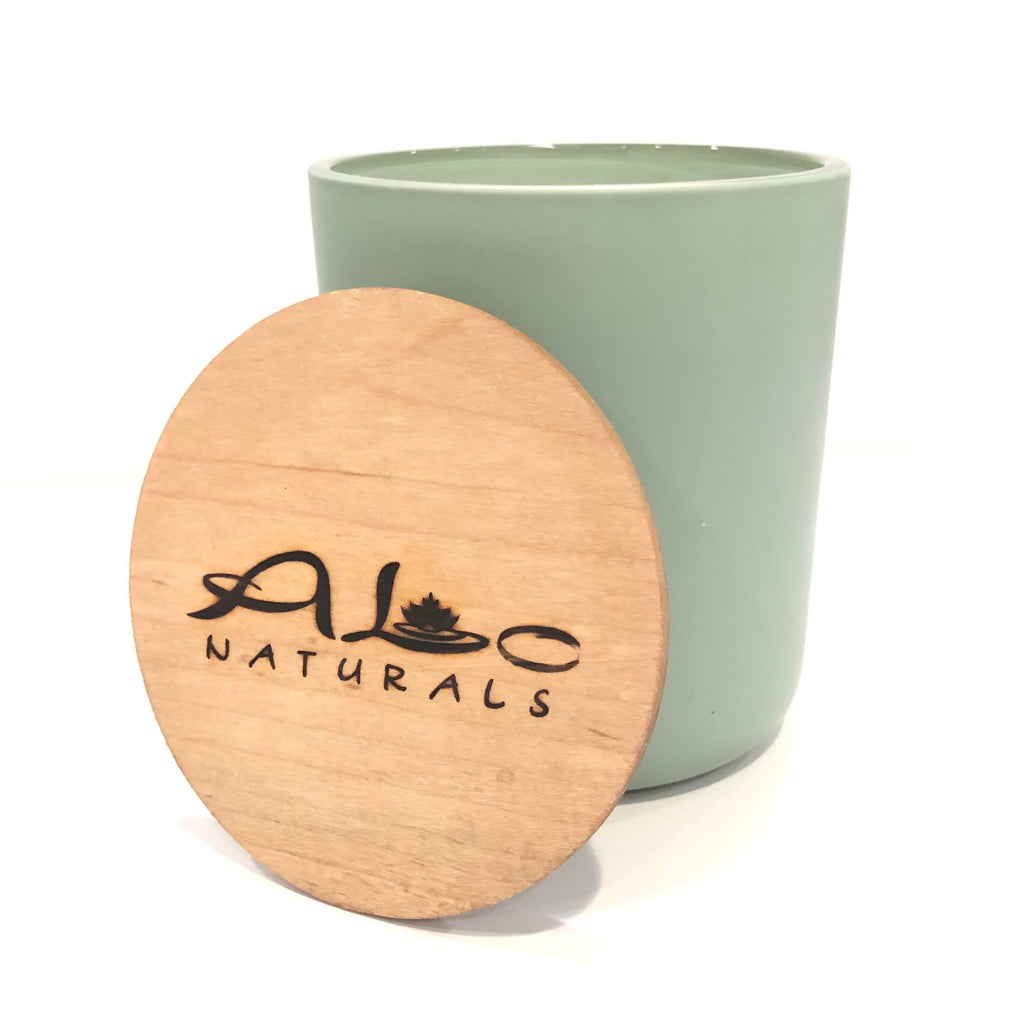 Hand poured Sage & Lavender scented soy candle.  Green painted glass vessel with wooden wick that crackles as it burns.  Includes a maple wood lid.  70 hours of burn time.
