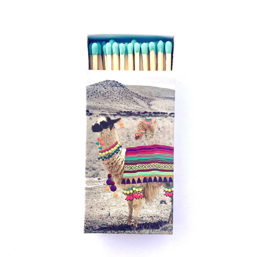 These Llama jumbo matches are perfect for lighting our hand poured soy candles!  These decorative matches are a lovely addition to enhance any home décor.  Our designer match boxes are reusable, and each comes with 50 matches tipped in blue.