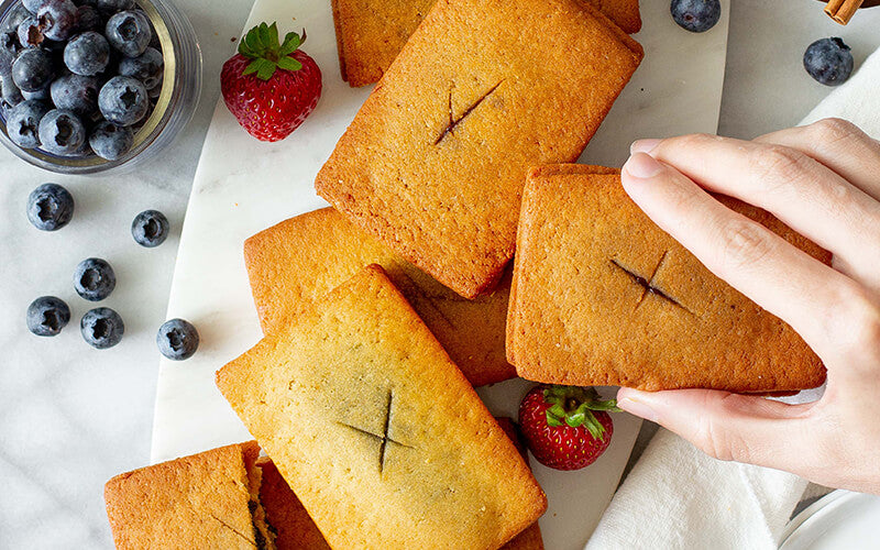 A hand grabbing a PBH Foods Keto Toaster Pastry
