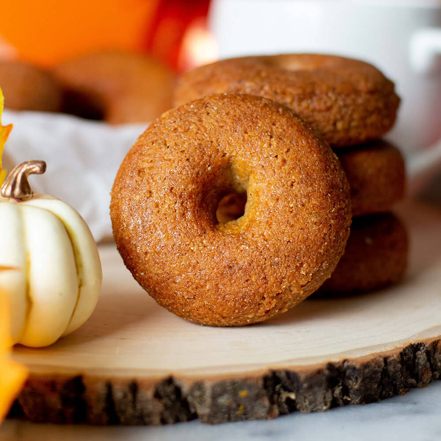 PBH Foods Keto Pumpkin Spice Donuts on wood plate