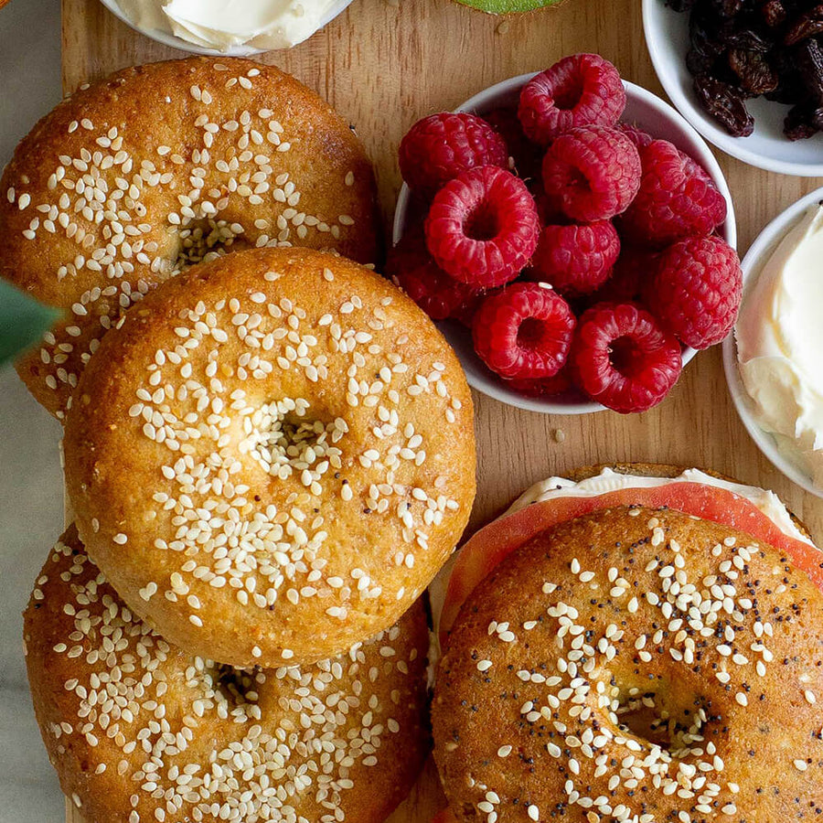 PBH Foods Keto Sesame Seed Bagels next to an Everything Bagel and raspberries