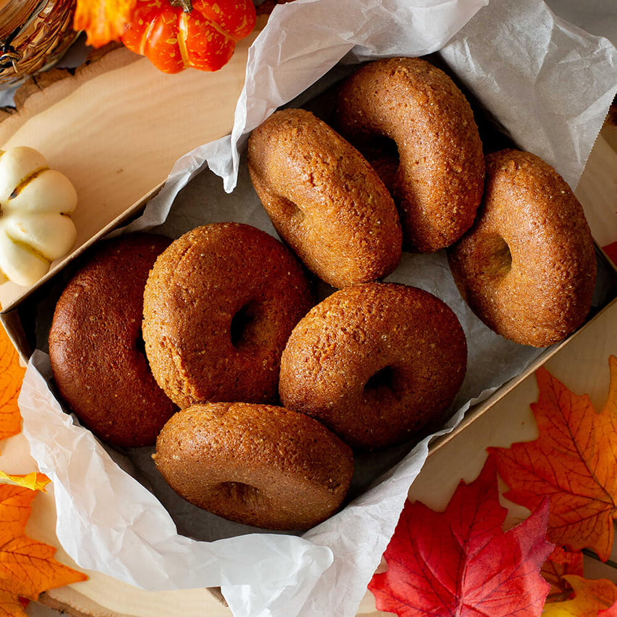Several PBH Foods Keto Pumpkin Spice Donuts in a box