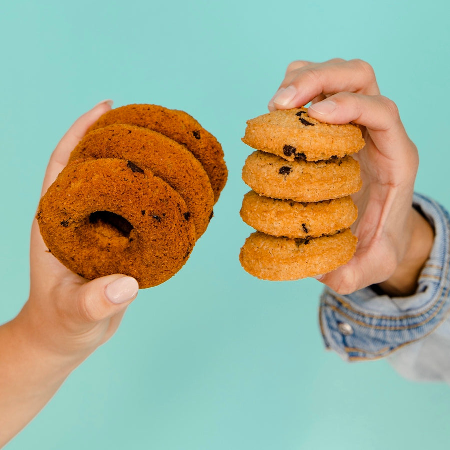 Image of a Keto Chocolate Chip Cookies and Keto Chocolate Chip Donuts Being Held In a Hands