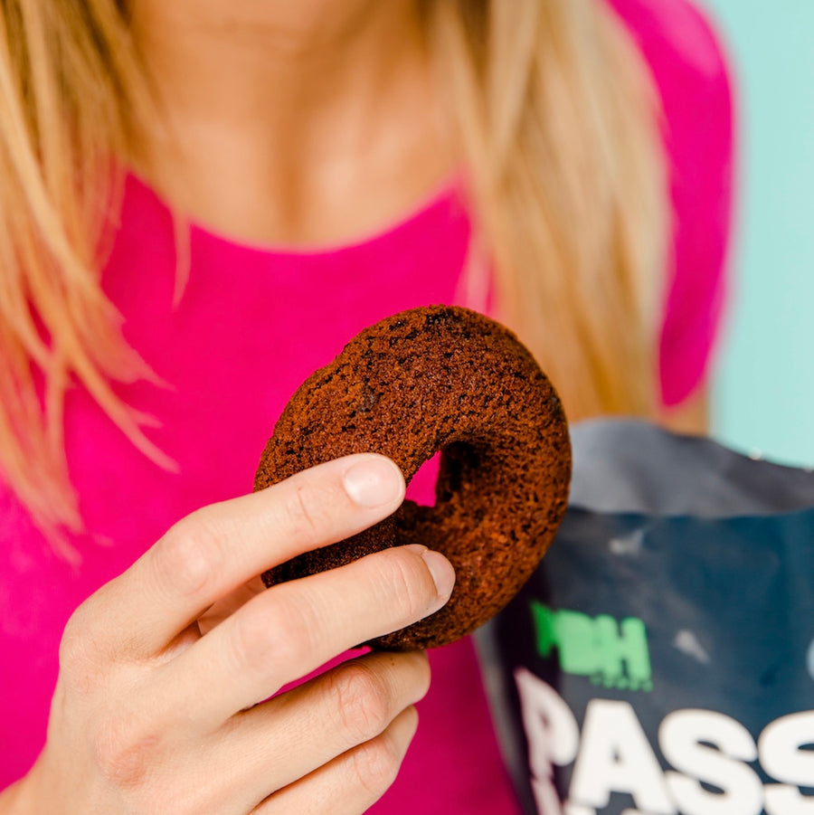 Photo of a Keto Double Chocolate Donut Being Held In a Hand from the Package