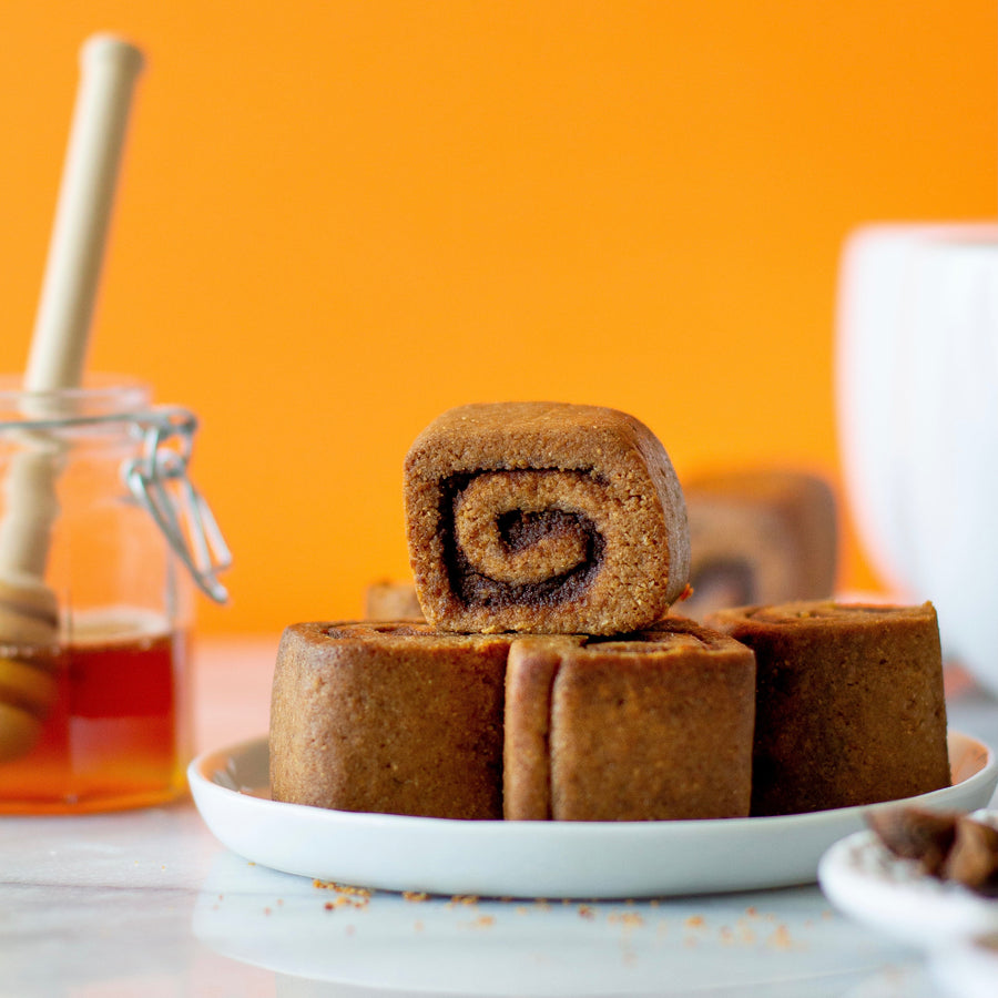 Paleo Pumpkin spice rolls with honey comb inside honey jar