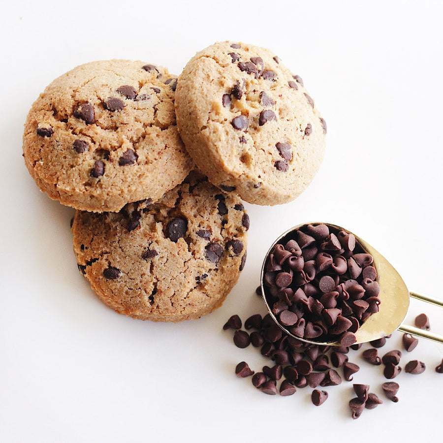 Photo of a Keto Chocolate Chip Cookies Next to Spoonful of Chocolate Chips
