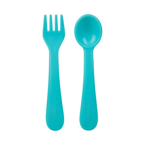 Turquoise plastic fork and plastic spoon