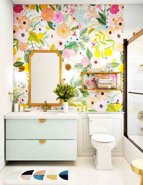 Photo of a bathroom with a bright floral wallpaper.