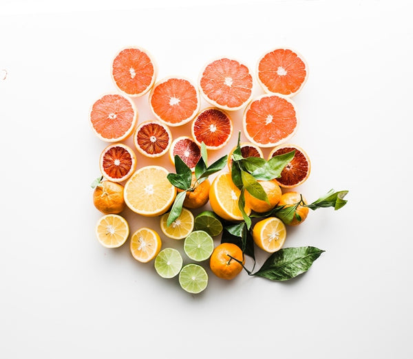 Sliced fruits flat lay photo.