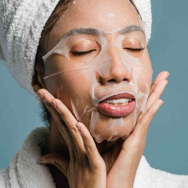 Black woman wearing a skin care face mask.