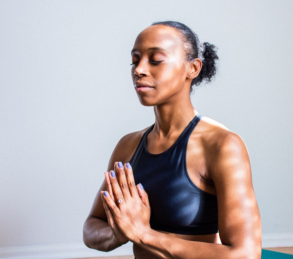 Black girl doing meditation.